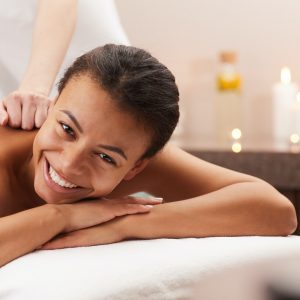 Smiling Woman Enjoying Massage