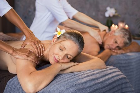 Mature couple having massage at spa