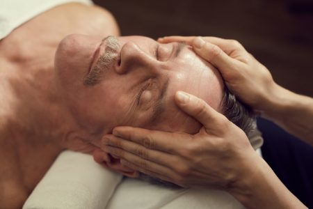 Senior Man Enjoying Facial Massage in SPA